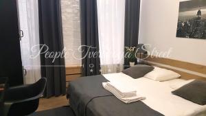 Кровать или кровати в номере Отель PEOPLE Тверская Стрит