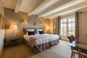 A bed or beds in a room at La Bastide Saint Georges & Spa
