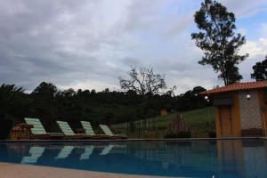 The swimming pool at or near Pousada Divina Minas