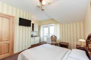 Ein Bett oder Betten in einem Zimmer der Unterkunft Vila Levita