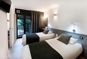 Cama o camas de una habitación en Hotel Mila