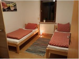 Ein Bett oder Betten in einem Zimmer der Unterkunft Ferienwohnung Ranch
