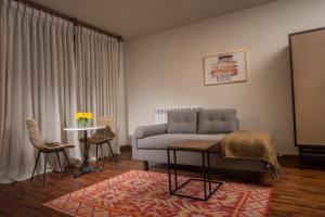 A seating area at Palacio Manco Capac by Ananay Hotels