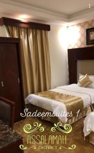 Cama ou camas em um quarto em Sadeem Hotel Apartments