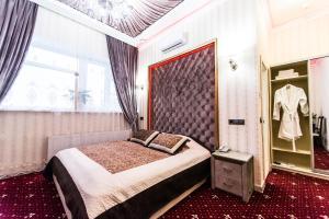 Кровать или кровати в номере Отель «Рай»