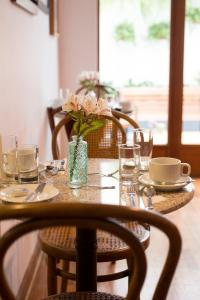 A restaurant or other place to eat at Belma Boutique Bed and Breakfast