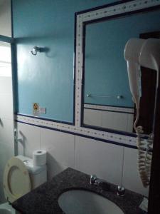 Um banheiro em Pousada Casa das Rosas