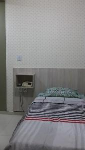 A bed or beds in a room at Juazeiro Residence Hotel