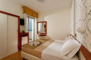 Letto o letti in una camera di Hotel Aristeo