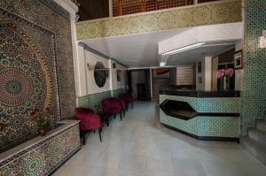 The lobby or reception area at Hotel De La Paix