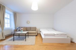 Un ou plusieurs lits dans un hébergement de l'établissement Beautiful City Apartment at famous Ballgasse (23)