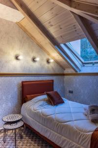 Ένα ή περισσότερα κρεβάτια σε δωμάτιο στο Villa Virginia Hotel