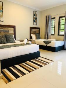 A bed or beds in a room at The Temak Villa