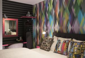 A bed or beds in a room at Village Hotel Bristol Filton