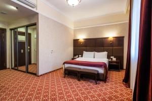 アタッシュ ホテルにあるベッド