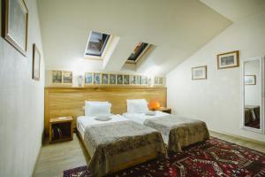 Кровать или кровати в номере Vinotel Boutique Hotel