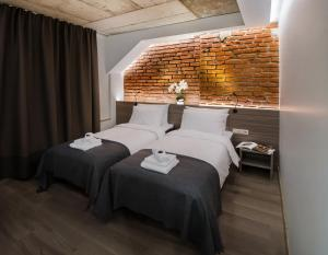 A bed or beds in a room at Dangė Hotel