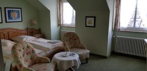 A bed or beds in a room at Akzent Hotel Gut Höing