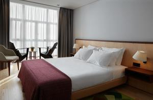 Uma cama ou camas num quarto em Abrigo da Montanha Hotel Rural