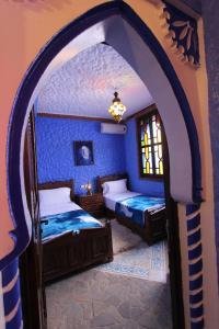 Cama o camas de una habitación en Résidence Hoteliére Chez Aziz