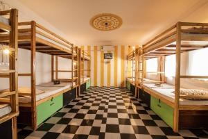 A bunk bed or bunk beds in a room at Hostelavie - Pushkar