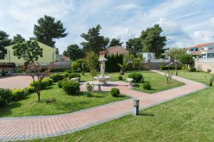 A garden outside Hotel Miramare
