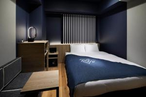 A bed or beds in a room at the square hotel GINZA