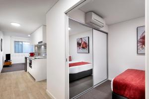 A television and/or entertainment center at Ramada by Wyndham VetroBlu Scarborough Beach