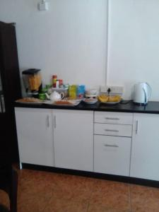 A kitchen or kitchenette at Overflow Guest House