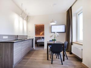 A kitchen or kitchenette at Dangė Hotel