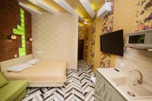 Кровать или кровати в номере Apartments on Nevsky 23