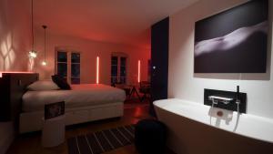Un ou plusieurs lits dans un hébergement de l'établissement MiHotel Vieux Lyon