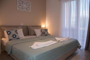 Letto o letti in una camera di Solon Apartments