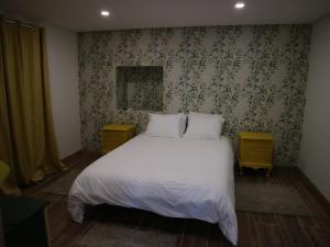 Uma cama ou camas num quarto em Quinta da Retorta