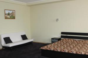 A bed or beds in a room at Verkhniy Miz