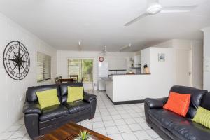 A seating area at 14 Double Island Drive - Rainbow Beach, Large Holiday House with Pool,Pets Welcome, Free Wi-Fi