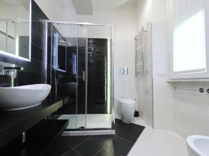 Um banheiro em B&B Aurelia Garden Rooms