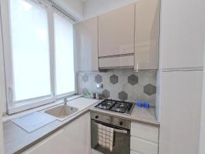 A cozinha ou cozinha compacta de B&B Aurelia Garden Rooms