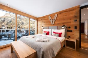 A bed or beds in a room at Chalet Nepomuk