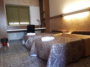 A bed or beds in a room at Albergue Peregrinos San Francisco de Asis