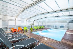 The swimming pool at or near Lagrange Apart'Hotel l'Escale Marine
