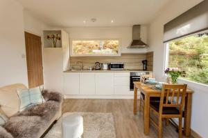 A kitchen or kitchenette at Loch Broom Chalets
