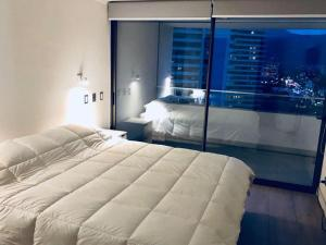 Cama o camas de una habitación en Sofistic Apartments