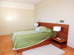 A bed or beds in a room at Villa Martin