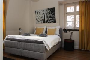 A bed or beds in a room at Apartment Am Völkerschlachtdenkmal