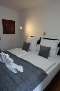 Кровать или кровати в номере Stern Hotel
