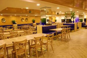 Um restaurante ou outro lugar para comer em Alambique de Ouro Hotel Resort & Spa