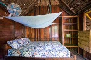A bed or beds in a room at The Humpback Turtle