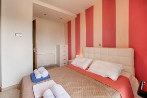 A bed or beds in a room at Villa Pandesia