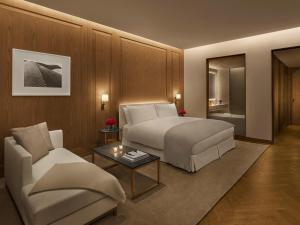 A bed or beds in a room at The Abu Dhabi EDITION